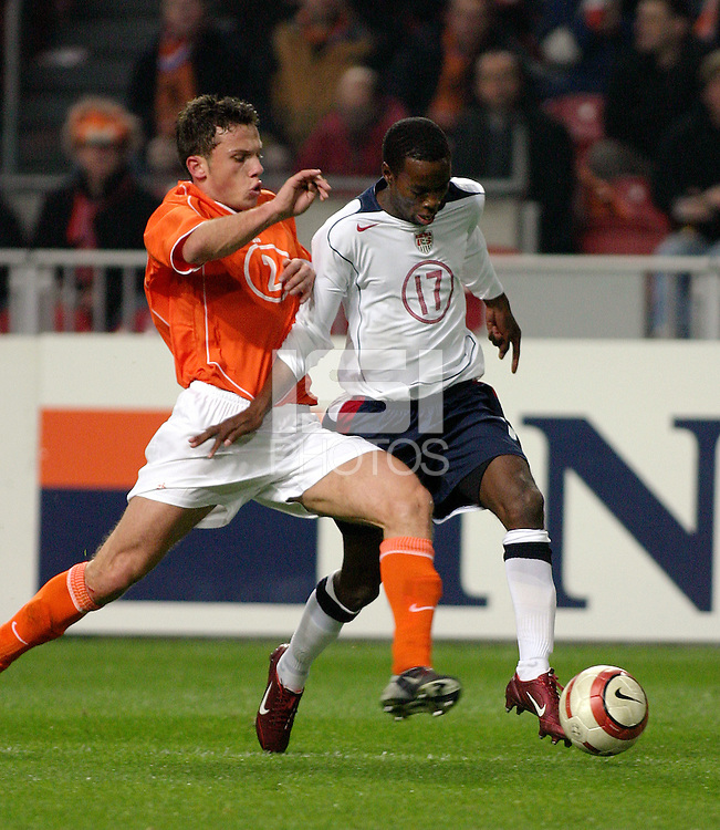 Demarcus Beasley (US) v Johnny Heitinga (HOL).US/Holland Amsterdam ArenA