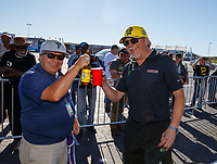 May 7, 2017; Commerce, GA, USA; NHRA photographer Richard Shute (left) with tuner Alan Johnson during the Southern Nationals at Atlanta Dragway. Mandatory Credit: Mark J. Rebilas-USA TODAY Sports