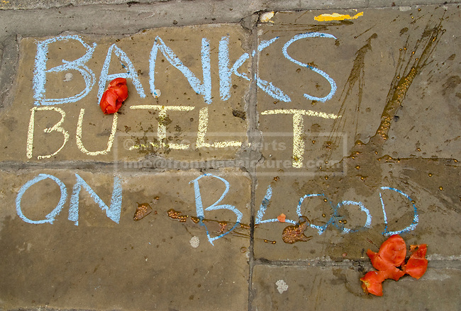 Graffiti and tomatoes cover the pavement outside the Bank of England.