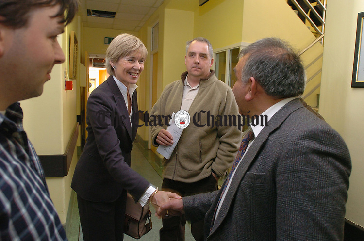 Minsister Liz Mc Manus meets Dr Moosajee Bhamjee in the corridor of Ennis General hospital during her visit to Ennis. als included are Labour election candidates Noel Hogan and Paschal Fitzgerald. Photograph  by John Kelly.