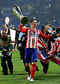 16th May 2018, Stade de Lyon, Lyon, France; Europa League football final, Marseille versus Atletico Madrid; Fernando Torres of Atletico Madrid celebrates as he lifts the Europa League Trophy in front of the Atletico Madrid fans with winners medal