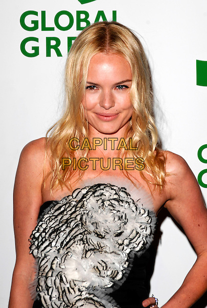 KATE BOSWORTH.The 6th Annual Global Green USA Pre-Oscar Party benefiting Green Schools held at Avalon in Hollywood, California, USA. .February 19th, 2009 .half length black dress white feathers corsage hand on hip strapless ruffled ruffles frills.CAP/ROT.©Lee Roth/Roth Stock/Capital Pictures