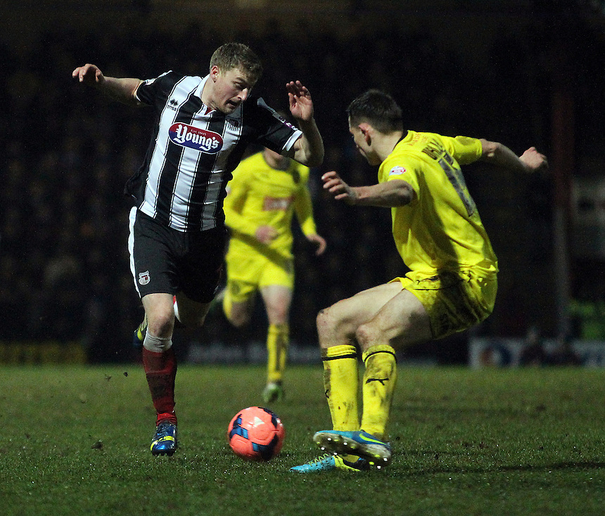 Grimsby Town's Joe Colbeck vies for possession with   Huddersfield Town's Murray Wallace <br /> <br /> Photo by Rich Linley/CameraSport<br /> <br /> Football - FA Challenge Cup Third Round - Grimsby Town v Huddersfield Town - Saturday 4th January 2014 - Blundell Park - Grimsby<br /> <br />  &copy; CameraSport - 43 Linden Ave. Countesthorpe. Leicester. England. LE8 5PG - Tel: +44 (0) 116 277 4147 - admin@camerasport.com - www.camerasport.com