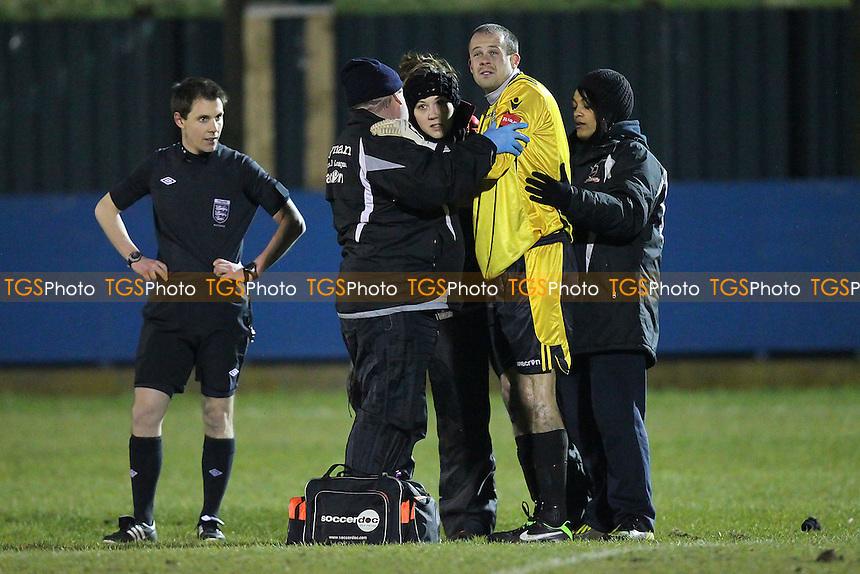 Injury concern for Thamesmead goalkeeper Robert Budd - Redbridge vs Thamesmead Town - Ryman League Division One North Football at Oakside, Barkingside - 26/03/13 - MANDATORY CREDIT: Gavin Ellis/TGSPHOTO - Self billing applies where appropriate - 0845 094 6026 - contact@tgsphoto.co.uk - NO UNPAID USE.