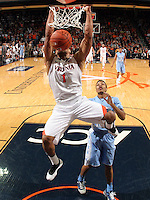 Virginia guard Justin Anderson (1) dunks the ball in front of North Carolina guard Nate Britt during an NCAA basketball game against Virginia Monday Jan. 20, 2014 in Charlottesville, VA. Virginia defeated North Carolina 76-61.