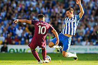 Sergio Aguero of Manchester City (10) is tackled by Lewis Dunk of Brighton & Hove Albion (5)   during the EPL - Premier League match between Brighton and Hove Albion and Manchester City at the American Express Community Stadium, Brighton and Hove, England on 12 August 2017. Photo by Edward Thomas / PRiME Media Images.