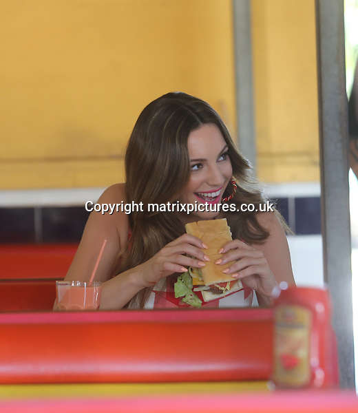 NON EXCLUSIVE PICTURE: MATRIXPICTURES.CO.UK.PLEASE CREDIT ALL USES..UK, AUSTRALIA, NEW ZEALAND AND ASIA RIGHTS ONLY..English model and media personality Kelly Brook is pictured wearing a red and white chequered summer dress whilst shooting on location for a new commercial in Little Havana, Miami today...The newly single beauty appears to have thrown herself into her work following her recent split from boyfriend Scottish rugby player Thom Evans...FEBRUARY 3rd 2013..REF: KDA 13719..XIM