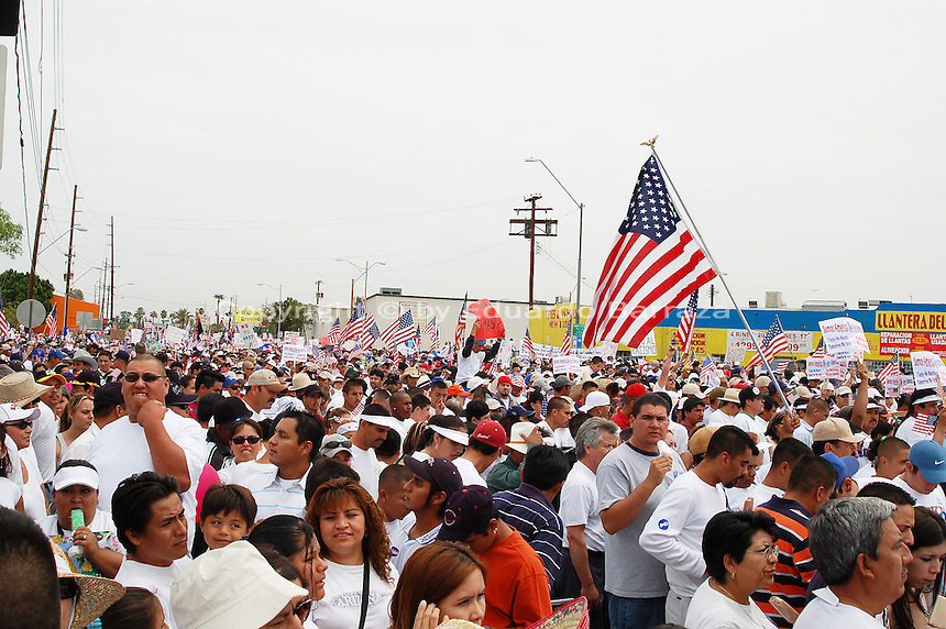 """Phoenix, Arizona. April 10, 2006 - Tens of thousands of immigrants from Latin America congregated at the grounds of the Veteran's Memorial Coliseum in Phoenix to march to the Arizona State Capitol. The march was one of many that took place around the country in 2006. Immigration marches totaled millions of illegal immigrants -all together- who for the first time took their plea for immigration reform to the streets. The protest in Phoenix and others in many other states in the U.S. protested a proposed legislation called """"Border Protection, Anti-terrorism, and Illegal Immigration Control Act of 2005,"""" also known as H.R. 4437 or Sensenbrenner Bill. This legislation sought to increase penalizations for illegal immigration and make undocumented immigrants and those who helped them enter or stay in the country as felons, and an additional 700 miles of fence along the U.S.-Mexico border, among other provisions. The marches pushed for a comprehensive reform of the immigration laws in the U.S., and a path to citizenship for all undocumented immigrants. Photo by Eduardo Barraza © 2006"""