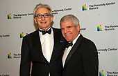Conductor Michael Tilson Thomas, left, and his husband, Joshua Robison, arrive for the formal Artist's Dinner honoring the recipients of the 42nd Annual Kennedy Center Honors at the United States Department of State in Washington, D.C. on Saturday, December 7, 2019. The 2019 honorees are: Earth, Wind & Fire, Sally Field, Linda Ronstadt, Sesame Street, and Michael Tilson Thomas.<br /> Credit: Ron Sachs / Pool via CNP