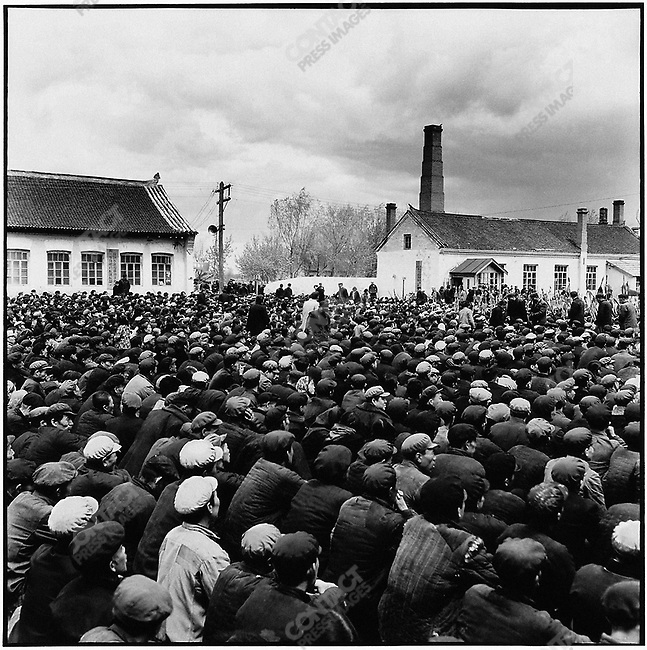 "Residents of the town of Acheng gather at a mass rally to denounce Hang Jingshan as a ""bad character"" and a ""speculator"" - someone involved in illegal commerce. He is arrested by the local police after publicly admitting his ""crime."" Acheng, Acheng county, 21 May 1965"