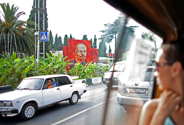 Investors have flooded the Russian beach town of Sochi since its award as the 2014 Winter Olympics location in an effort to create a Mediterranean-style resort. Here, a bus rider glances at a mural of the Russian communist politician Vladimir Lenin on Tuesday, August 12, 2008. <br /> <br /> As the mountainous Black Sea resort Sochi, Russia, prepares for the Winter Olympic games scheduled there for 2014, it emerges as a place replete with contradictions -- glitzy clubs and impoverished street vendors, progress and repression, Westernization and former Eastern bloc ideologies.