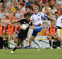 Andy Najar (14) of D.C. United fights for the ball with Tyson Wahl (5) of the Montreal Impact during the game at RFK Stadium in Washington DC.   D.C. United defeated the Montreal Impact, 3-0.