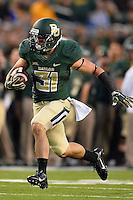 Baylor running back Silas Nacita (31) rushes with the ball during NCAA football game, Saturday, November 01, 2014 in Waco, Tex. Baylor defeated Kansas 60-14. (Mo Khursheed/TFV Media via AP Images)