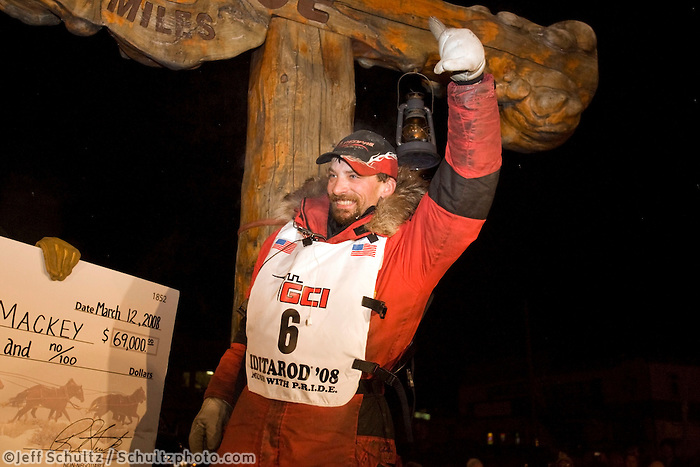 Lance Mackey is all smiles as he accepts his $69,000 first place prize money check from race sponsor Wells Fargo after winning the 2008 Iditarod