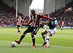 Leon Clarke of Sheffield Utd in action with Shaun Hutchinson of Millwall during the championship match at the Bramall Lane Stadium, Sheffield. Picture date 14th April 2018. Picture credit should read: Simon Bellis/Sportimage
