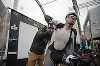 Fabian Cancellara (CHE/TrekFactoryRacing) getting his race radio checked by Press Officer Tim Vanderjeugd on the start podium in Bruges before the start<br /> <br /> Ronde van Vlaanderen 2014
