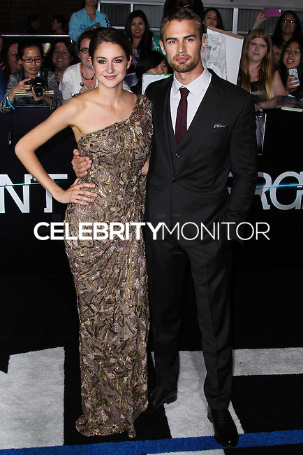 """WESTWOOD, LOS ANGELES, CA, USA - MARCH 18: Shailene Woodley, Theo James at the World Premiere Of Summit Entertainment's """"Divergent"""" held at the Regency Bruin Theatre on March 18, 2014 in Westwood, Los Angeles, California, United States. (Photo by Xavier Collin/Celebrity Monitor)"""