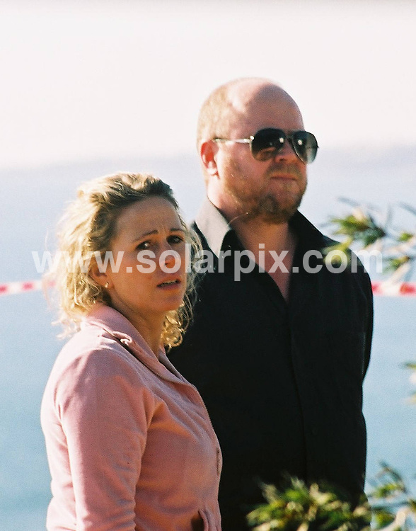 **ALL ROUND PICTURES FROM SOLARPIX.COM**.**WORLDWIDE SYNDICATION RIGHTS**.Eastenders filming in the Algarve, Portugal in 2003..This pic: Lucy Benjamin and Steve McFadden..JOB REF: 10954 PPL     DATE: 15_01_2003.**MUST CREDIT SOLARPIX.COM OR DOUBLE FEE WILL BE CHARGED**.**MUST NOTIFY SOLARPIX OF ONLINE USAGE**.**CALL US ON: +34 952 811 768 or LOW RATE FROM UK 0844 617 7637**