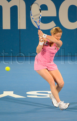 14.01.2011 The Medibank International Tennis series from the Sydney Olympic Park. Kim Clijsters of Belgium returns a shot in her match against Na Li of China on day six of the 2011 Medibank International at the Sydney Olympic Park Tennis Centre in Sydney, Australia.