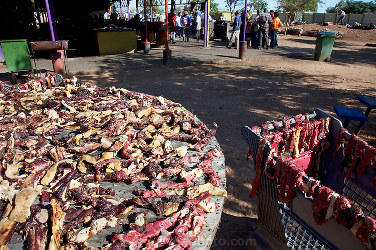 Flies feasting on kapana (strips of freshly butchered beef) don't seem to bother customers at the busy Oshetu Market near the Katutura area of Windhoek, Namibia. (From the book What I Eat: Around the World in 80 Diets.)