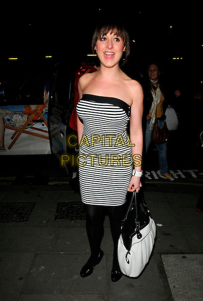 "NATALIE CASSIDY .Attending the ""Into The Hoods"" Gala Performance at the Novello Theatre, London, England, March 27th 2008..Full length strapless black and white striped dress  fringe hand on hip bag .CAP/CAN.©Can Nguyen/Capital Pictures"