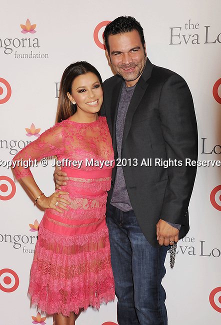 HOLLYWOOD, CA- SEPTEMBER 28: Actors Eva Longoria and Ricardo Antonio Chavira arrive at the Eva Longoria Foundation Dinner at Beso restaurant on September 28, 2013 in Hollywood, California.