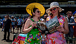 June 8, 2019 : Two women read the day's racing program on Belmont Stakes Festival Saturday at Belmont Park in Elmont, New York. Scott Serio/Eclipse Sportswire/CSM