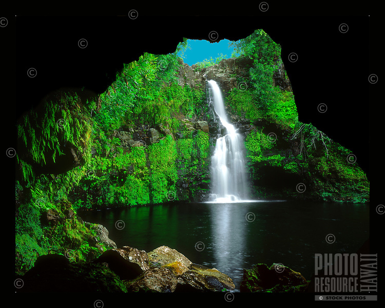 "Waikaumalo Cave: A tranquil waterfall in the uplands of Waikaumalo Stream as viewed from inside a deep lava tube, Hawai'i Island. Shot on 4x5"" transparency film, available only as a fine art print."
