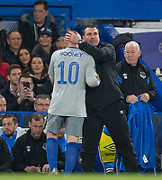 Everton Caretaker Manager David Unsworth with Wayne Rooney of Everton as he is substituted during the Carabao Cup round of 16 match between Chelsea and Everton at Stamford Bridge, London, England on 25 October 2017. Photo by Andy Rowland.