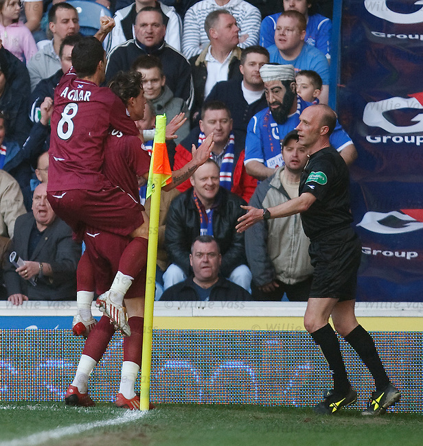 Ruben Palazuelos celebrates his goal for Hearts but Osama Bin Laden is not impressed as his cover is blown in the Rangers support