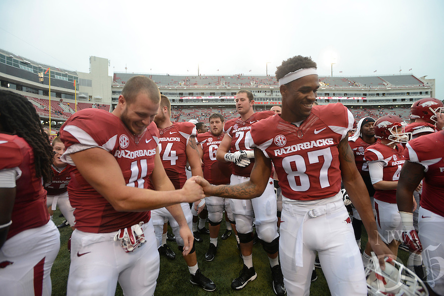 STAFF PHOTO ANTHONY REYES &bull; @NWATONYR<br /> Razorbacks A.J. Derby (11) and Kendrick Edwards, celebrate a win against Nicholls State in the fourth quarter Saturday, Sept. 6, 2014 at Razorback Stadium in Fayetteville. The Hogs won 73-7.