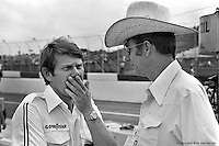 HAMPTON, GA - APRIL 22: Tyler Alexander (left) of Team McLaren speaks with Jim Hall (right), team owner for Al Unser, in the pit lane before practice for the Gould Twin Dixie 125 event on April 22, 1979, at Atlanta International Raceway near Hampton, Georgia.