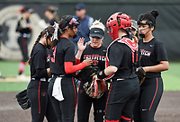 NWA Democrat-Gazette/CHARLIE KAIJO Northside High School players huddle during the 6A State Softball Tournament, Thursday, May 9, 2019 at Tiger Athletic Complex at Bentonville High School in Bentonville. Rogers Heritage High School lost to Northside High School 8-6