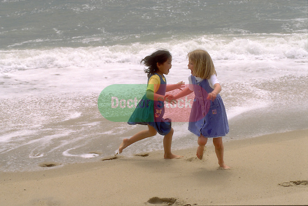 young girls playing at beach