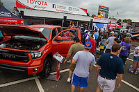 Jun 6, 2015; Englishtown, NJ, USA; Fans check out a new Toyota truck as fans file by to an autograph session in the NHRA Toyota display during qualifying for the Summernationals at Old Bridge Township Raceway Park. Mandatory Credit: Mark J. Rebilas-