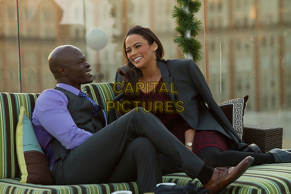 Djimon Hounsou, Paula Patton<br /> in Baggage Claim (2013) <br /> *Filmstill - Editorial Use Only*<br /> CAP/FB<br /> Image supplied by Capital Pictures