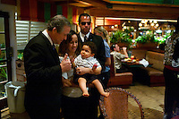 George Bush impersonator poses with guests at The Hawaiian Breeze Restaurant, Orlando Florida