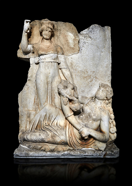 Roman Sebasteion relief  sculpture of the goddess Roma and Ge (Earth),  Aphrodisias Museum, Aphrodisias, Turkey.  Against a black background. <br /> <br /> The goddess Roma holds a spear and wears a crown in the form of a city wall. Earth reclines half naked leaning on a pile of fruit. She holds a cornucopia full of more fruit. A baby child (now damaged) climbs up the horn she holds. The relief represents Earths fertility and abundance overseen by Rome.