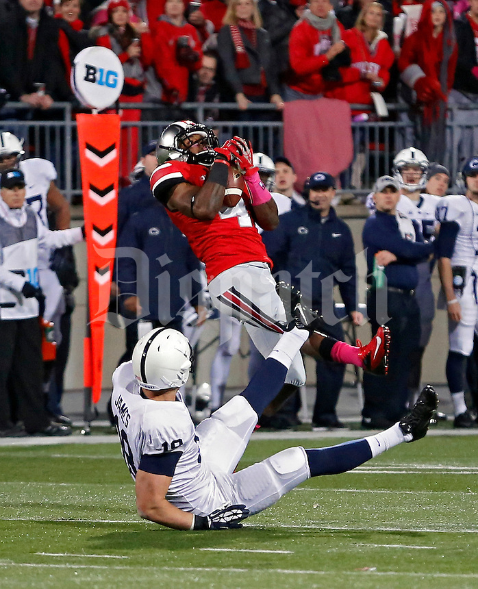 Ohio State Buckeyes safety C.J. Barnett (4) makes an interception against Penn State Nittany Lions tight end Jesse James (18) in the 1st quarter at Ohio Stadium on October 26, 2013.  (Dispatch photo by Kyle Robertson)