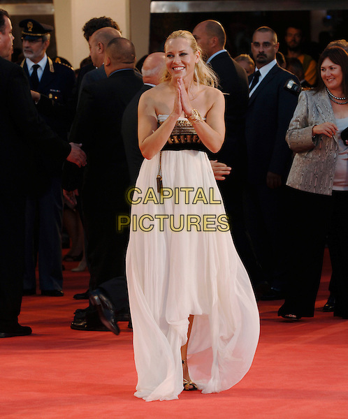 "MARIA BELLO.""World Trade Center"" screening arrivals.63rd Venice International Film Festival.Venice, Italy.1st September 2006.Ref: PL.full length hands together pray praying thanking strapless white dress gold .www.capitalpictures.com.sales@capitalpictures.com.©Phil Loftus/Capital Pictures"