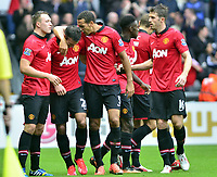 Manchester united celebrating their third goal, scored by Robin Van Persie.<br />