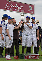 The Winners Thai Owned 'King Power Foxes' hold up the Cup during the Cartier Queens Cup Final match between King Power Foxes and Dubai Polo Team at the Guards Polo Club, Smith's Lawn, Windsor, England on 14 June 2015. Photo by Andy Rowland.