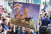 London, UK. 2 July 2016. Artist Kaya Mar holds up a Farage-Boris painting. Tens of thousands gather in Central London to protest against the Brexit EU Referendum on a March for Europe.