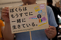 AIDS awareness stall at Tokyo Rainbow Pride festival, Yoyogi Park, Tokyo, Japan. Sunday April 27th 2014 This was the third year this annual gay-pride event has been held in Japan capital.with food, fashion and health care stalls and musical performances set up in Yoyogi Park event square and a colourful parade around Shibuya at 1pm.