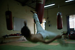 A fighter from Manipur practices his kicks before the Fight Night in Mumbai.