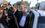 "Hamas Chief Ismail Haniyeh flashes the victory gesture upon his arrival on the Palestinian side of the Rafah border crossing, in the southern Gaza Strip on September 19, 2017. Haniyeh said on Tuesday evening that his movement is ready to receive the Palestinian Unity Government in Gaza during a press conference held immediately after returning to the Gaza Strip from Cairo, he said: ""To show Hamas' seriousness to bring about reconciliation, we invite the unity government to come and assume its duties in Gaza unimpeded."". Photo by Yasser Qudih"