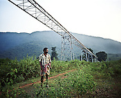 One of the villagers (name withheld) poses for a photograph on his land that was forcibly taken by him for the construction of a trolley way. Now since the conveyor trolley belt is constructed, Vedanta sources say the company is ready with the mining plan. Bauxite ores will be extracted from the hilltop and will be brought to the plant site through a conveyor belt.