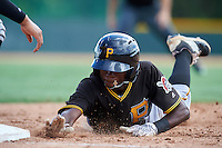Pittsburgh Pirates Victor Ngoepe (60) dives back to first base during an Instructional League Intrasquad Black & Gold game on September 28, 2016 at Pirate City in Bradenton, Florida.  (Mike Janes/Four Seam Images)