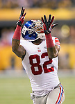 New York Giants wide receiver Mario Manningham (82) catches a pass during the NFL Super Bowl XLVI football game against the New England Patriots on Sunday, Feb. 5, 2012, in Indianapolis. The Giants won 21-17 (AP Photo/David Stluka)...