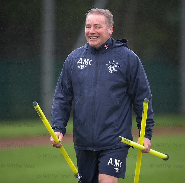 Ally McCoist laughing as the rain comes down at training